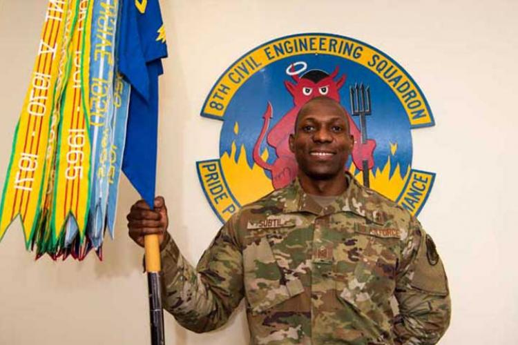 U.S. Air Force Master Sgt. Larwens Subtil, 8th Civil Engineer Squadron first sergeant, poses for a photo in his office at Kunsan Air Base, Republic of Korea, Jan. 11, 2019. Subtil immigrated to the U.S. from Haiti, joined the Air Force, and is currently serving his 15th year in the military. (U.S. Air Force photo by Staff Sgt. Joshua Edwards)