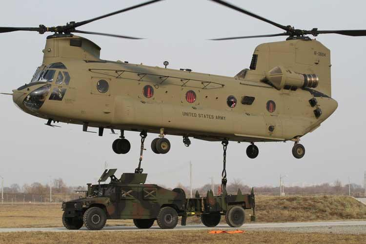 A CH-47 Chinook helicopter prepares to lift an armored High Mobility Multipurpose Wheeled Vehicle after Soldiers from the 123rd Brigade Support Battalion, 3rd Brigade Combat Team, 1st Armored Division, completed hookup procedures Jan. 7 at Camp Humphreys, Republic of Korea. Sling load operations test Soldiers' ability to move equipment from location to location. (U.S. Army photo by Pfc. Edwin Petzke, 20th Public Affairs Detachment)