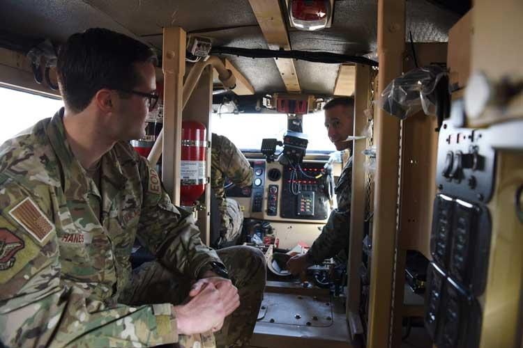 U.S. Marine Corps Sgt. Maj. Anthony Spadaro, right, U.S. Pacific Command senior enlisted leader, discusses the operational uses of the joint explosive ordnance disposal rapid response vehicle with Senior Airman Gideon Hanes, 51st Civil Engineer squadron EOD technician, at Osan Air Base, Republic of Korea, Jan. 28, 2019. During his visit to Osan, Spadaro was briefed about the skills various units on base possessed. (U.S. Air Force photo by Airman 1st Class Ilyana A. Escalona)