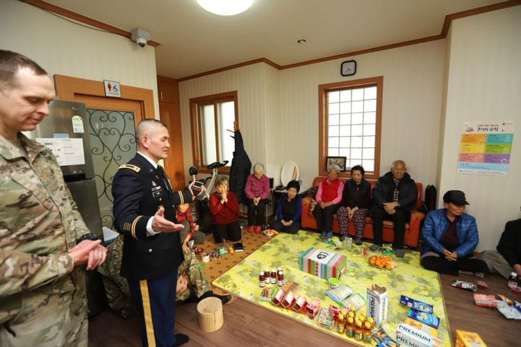 PYEONGATAEK, Republic of Korea – Chaplain (Lt. Col.) Kim, Hyeon Joong, Seoul native, division chaplain, 2nd Infantry Division/ROK-U.S. Combined Division, leads the room in prayer during the visit to Song Hwa Senior Community Center as part of the U.S. Forces Korea Good Neighbor Program, Feb. 12. (U.S. Army photo by KATUSA Cpl. Park, Seung Ho, 2ID/RUCD Public Affairs)