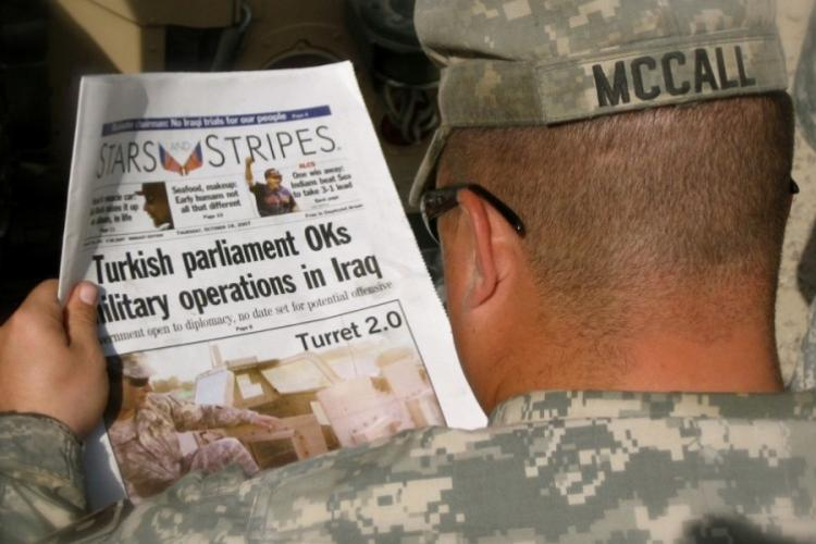 U.S. Army Sgt. Roger McCall, 153rd Military Police Company, reads an edition of Stars and Stripes while in the Green Zone, Baghdad, Oct. 18, 2007. (SGT. BRENDAN MACKIE/U.S. ARMY NATIONAL GUARD)