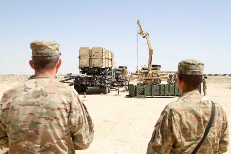 U.S. Army officials watch crews as they practice Patriot Missile Defense System reloading procedures during training in Kuwait on March 25, 2016. (DAVID N. BECKSTROM/U.S. ARMY)