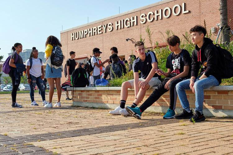 Students connect with friends outside Humphreys High School at Camp Humphreys, South Korea, Monday, Aug. 26, 2019. (MATTHEW KEELER/STARS AND STRIPES)