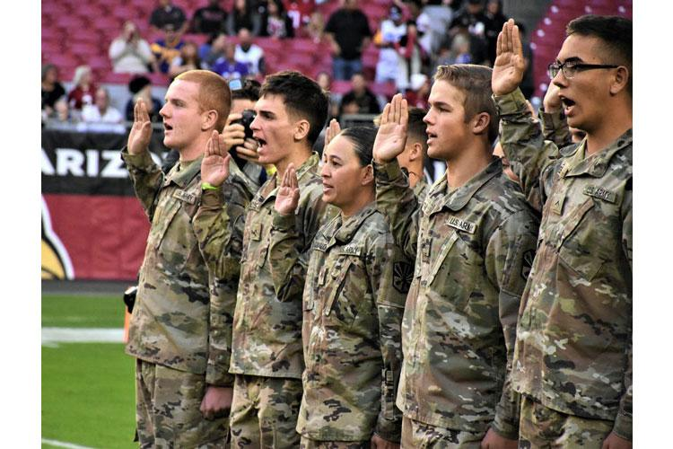 Future soldiers recite the oath of enlistment during a ceremony at State Farm Stadium in Glendale, Ariz., Dec. 1, 2019. (ALUN THOMAS/U.S. ARMY)