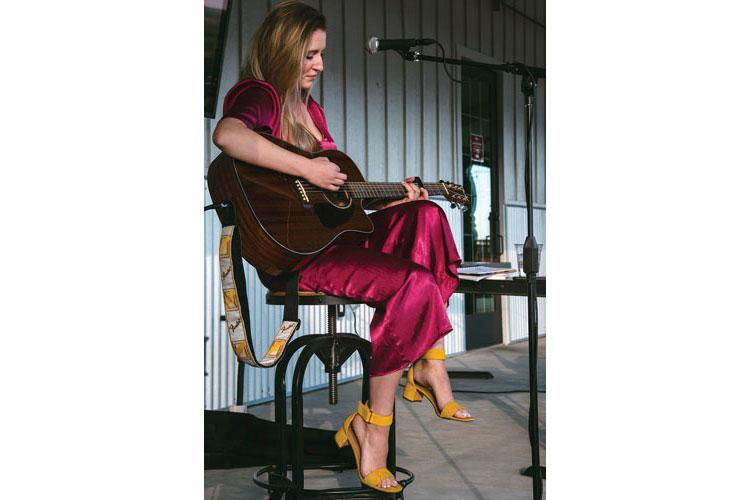"Ally Westover plays a coffee house in Colorado prior to the release of her debut single ""Lullaby."" (Courtesy photos)"