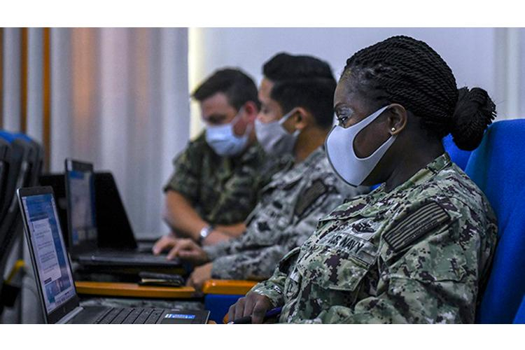 U.S. Navy Cmdr. Helen Cann, senior medical officer, participates in a pandemic preparation and response virtual engagement in support of Exercise Obangame Express 2021, March 16, 2021. (Photo by: U.S. Navy Mass Communications Specialist 3rd Class Trey Fowler)