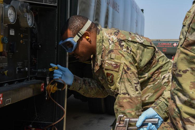 U.S. Air Force Tech. Sgt. Quincy Moore, 8th Logistics Readiness Squadron fuels laboratory NCO in charge, performs a monthly sediment and water test on a refueling unit using an inline sampler at Kunsan Air Base, Republic of Korea, April 3, 2020. These inline samplers are used to grab the sample to verify the fuel quality. (U.S. Air Force photo by Senior Airman Jessica Blair)