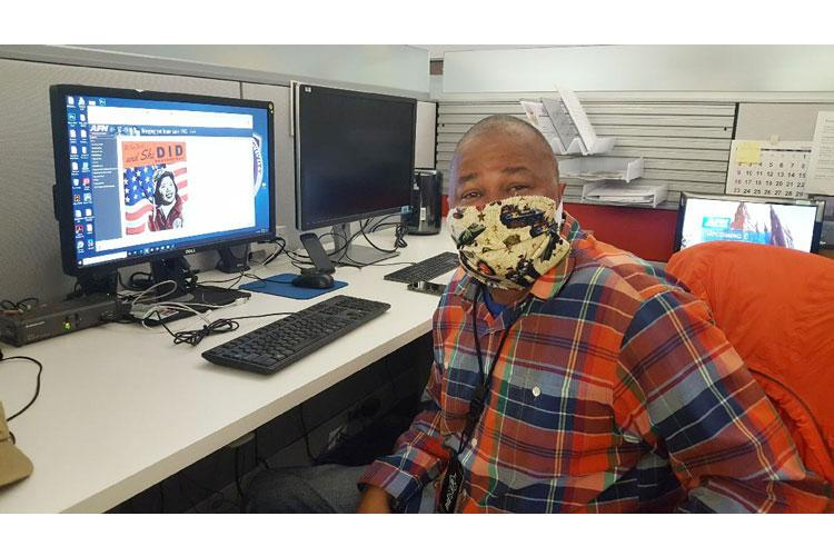 Kevin Davis, an editor at the American Forces Network (AFN) Broadcast Center, sports a cloth mask sewn by a co-worker as he continues his mission.  Davis helps AFN provide the overseas military with morale-building TV entertainment, COVID-19 force protection messages and live news. (DoD photo)