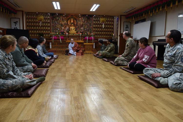 Republic of Korea Air Force Capt. Sungcheol Lee, 38th Fighter Group chaplain, instructs U.S. and ROKAF Airmen in meditation at Kunsan Air Base, Republic of Korea, April 11, 2019. Chaplains sponsored a joint two-day course including guided meditation, a traditional meal, learning the basic history of Buddhism, and temple visits. (U.S. Air Force photo by Staff Sgt. Joshua Edwards)