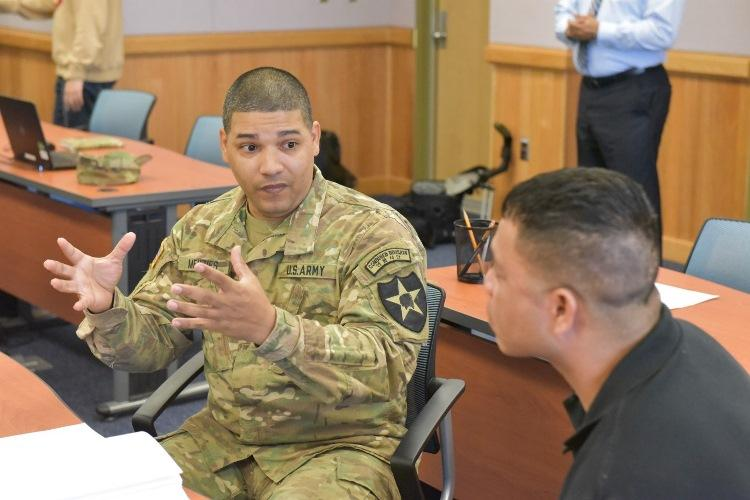 Sgt. 1st Class John Menzies assigned to Humphreys 2ID, participates in a mock job interview during a Soldier For Life - Transition Assistance Program class at the One Stop (Bldg. 6400). (U.S. Army Photo by Abigail Chipps, USAG-H Public Affairs High School Intern)