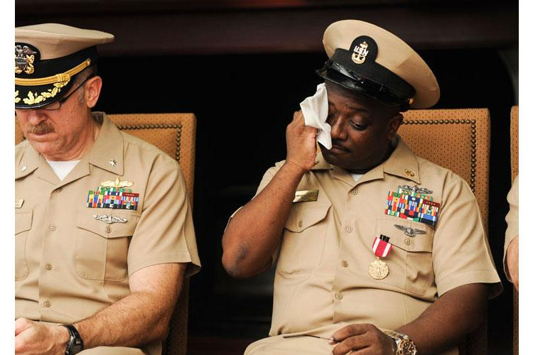 ARABIAN GULF (Sept. 29, 2015) Senior Chief Machinery Repairman James Slay wipes away tears during his retirement ceremony in the fo'c'sle aboard the aircraft carrier USS Theodore Roosevelt (CVN 71). (U.S. Navy photo by Mass Communication Specialist 3rd Class Anna Van Nuys)