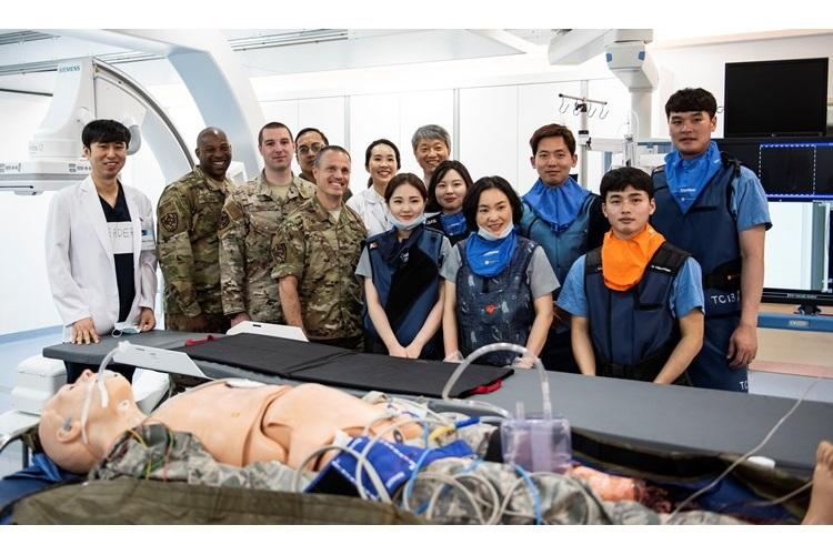 Leadership from the 8th Medical Group pose for a photo with medical staff at Wonkwang University Medical Center, Republic of Korea, May 8, 2019. The surgical team at Wonkwang successfully performed a life-saving operation on a simulated patient transported via helicopter from Kunsan Air Base, paving the way for a continued relationship between the medical center and Kunsan. (U.S. Air Force photo by Senior Airman Stefan Alvarez)