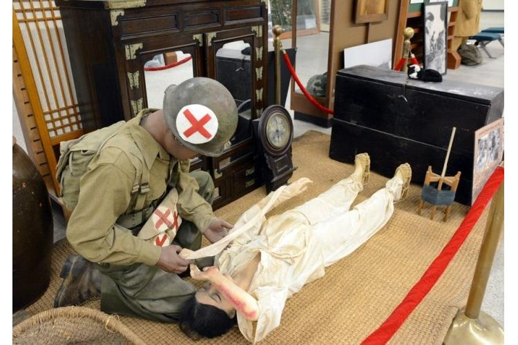 A display showing an American medic treating a wounded Korean woman in a traditional home is seen at the new 2nd Infantry Division/Eighth Army/Korean Theater of Operations museum on Camp Humphreys, South Korea, Wednesday, June 5, 2019. (KIM GAMEL/STARS AND STRIPES)