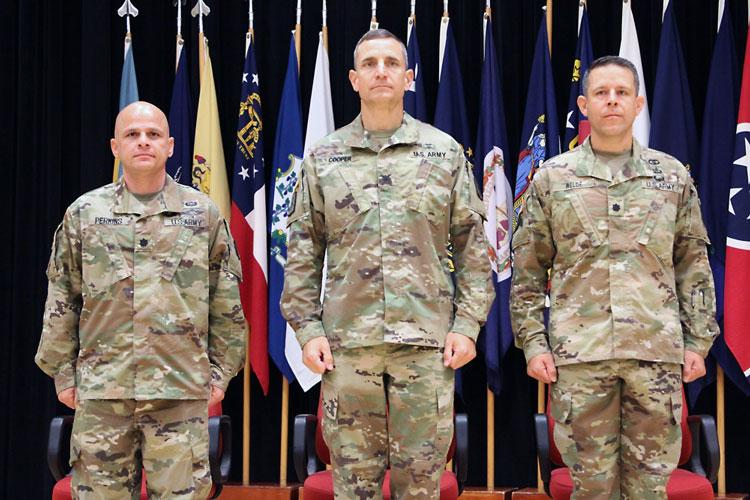 Lt. Col. Marcus D. Perkins, left, new commander of the U.S. Army Medical Materiel Center-Korea, stands with Col. Derek C. Cooper, center, and Lt. Col. Marc R. Welde. Cooper, commander of the 65th Medical Brigade, served as the stand in for Col. Michael Lalor, commander of Army Medical Logistics Command, during a Change of Command ceremony on June 18 at Camp Carroll. (Courtesy Photo)