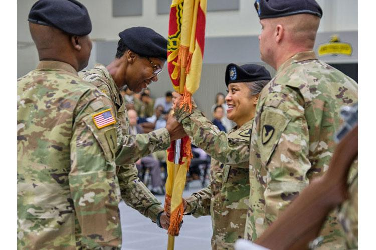 Col. Monica Washington, left, passes command of U.S. Army Garrison Yongsan-Casey to Lt. Col. Diosabelle Buack at Camp Casey, South Korea, Tuesday, July 2, 2019. (MATTHEW KEELER/STARS AND STRIPES)