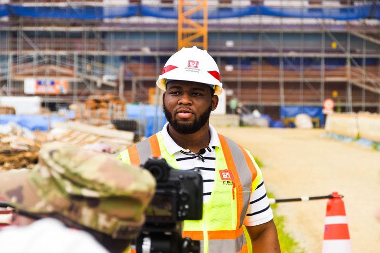 Samuel Coleman, a Tennessee State University senior civil engineering major, is interviewed at a construction site, Camp Humphreys, South Korea, July 15. Coleman is currently working as an intern at the U.S. Army Corps of Engineers, Far East District, as a part of the Advancing Minorities Interest in Engineering program. (Photo Credit: Antwaun Parrish)
