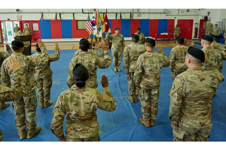 19th Expeditionary Sustainment Command commander Brig. Gen. Mark T. Simerly administers the oath of enlistment to 19 Soldiers during a ceremony on the units 55th anniversary at Camp Walker, Daegu, Republic of Korea July 15, 2019 (Photo By Kevin Bell)