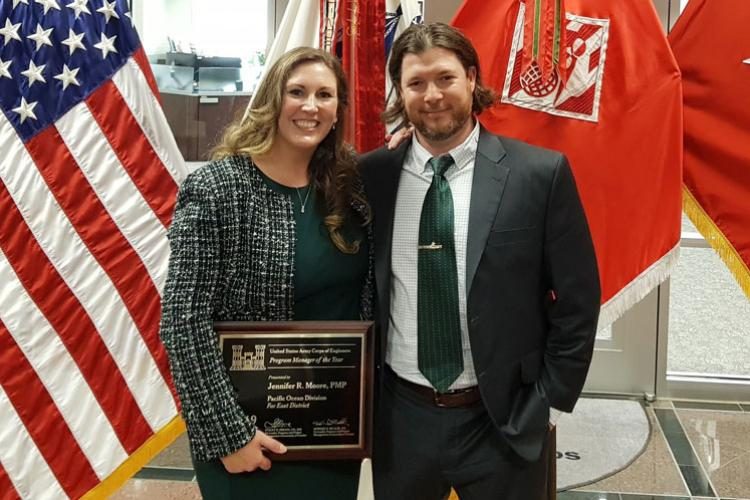 Jennifer Moore, U.S. Army Corps of Engineers (USACE), Far East District (FED), Air Force Program Branch Chief, stands with her husband Ross Moore, Security Operations Branch, physical security specialist, after being awarded the USACE Program Manager of the Year award, Washington, D.C., Aug. 2.