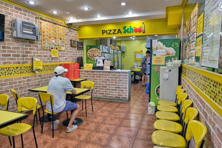 Get a freshly prepared pizza in as little as 10 minutes at Pizza School near Osan Air Base in Songtan, South Korea. (MATTHEW KEELER/STARS AND STRIPES)