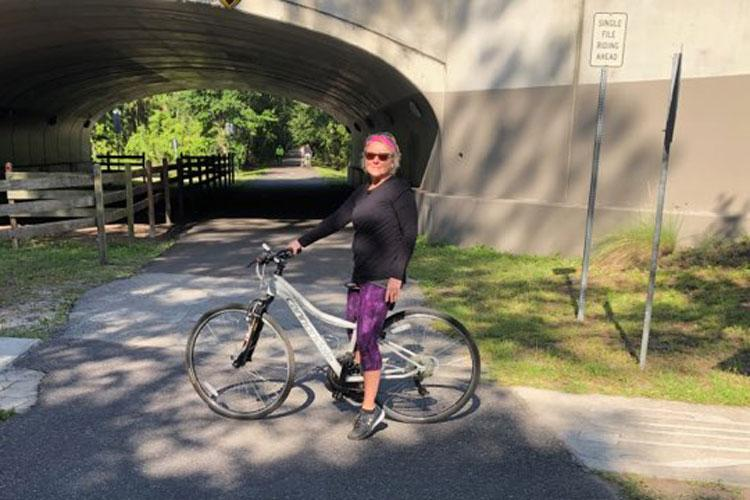 Jennifer Brown's cousin, Karen, on her bike after recovering from a heart attack. The health crisis helped Brown and her family grow stronger together.