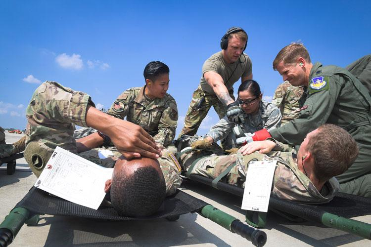 Team Osan members prepare to transport injured Army patients during Operation Ascending Eagle, Aug. 28, 2019, at Osan Air Base, Republic of Korea. Air Force and Army medics jointly operated in the simulated large casualty training to enhance their aeromedical evacuation and patient transportation procedures. (U.S. Air Force photo by Staff Sgt. Greg Nash)