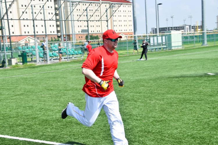 Brian Quiroga, a U.S. Army Corps of Engineers, Far East District project manager, runs to first base during a fall tournament softball game, Camp Humphreys, South Korea, Sep. 15. The district hasn't had a team since 2015, and this season decided to participate in the league.