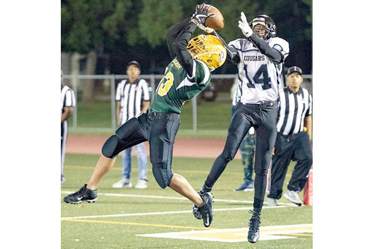 Robert D. Edgren's Damien San Nicolas intercepts a pass intended for Osan's Jaylon Grant. (JASON WYSONG/SPECIAL TO STRIPES)