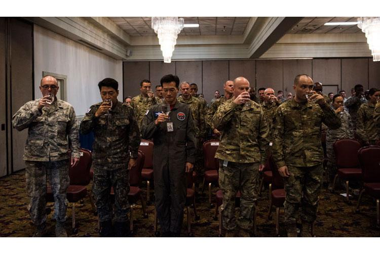 Leaders from the 8th Fighter Wing and Republic of Korea Air Force's 38th Fighter Group toast during a prisoners of war and missing in action memorial ceremony at Kunsan Air Base, Republic of Korea, Sept. 20, 2019. There are currently more than 81,000 POW/MIAs, and over 70 percent of them are in the Indo-Pacific region. (U.S. Air Force photo by Senior Airman Stefan Alvarez)