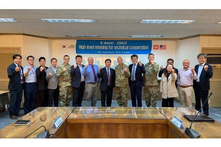 K-water Chief Research Officer Dr. Park, Jae Young (center), Maj. Gen. Anthony C. Funkhouser (center right) and senior leaders pose for a group photo. (Photo Credit: Courtesy)