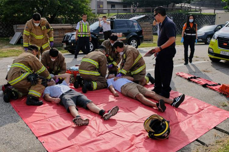 Firefighters from the U.S. Army Garrison Yongsan Fire Department treat role-players for knife wounds during a training exercise on the base in South Korea on Thursday, Sept. 26, 2019. (MATTHEW KEELER/STARS AND STRIPES)