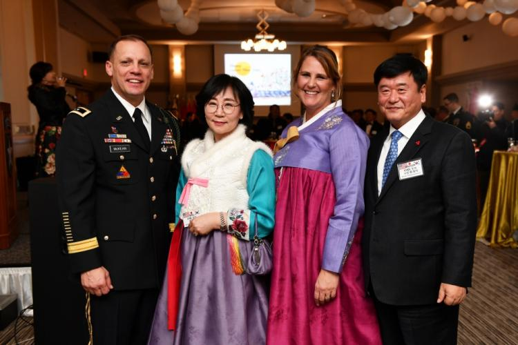 CAMP CASEY, Republic of Korea – Maj. Gen. D. Scott McKean, 2nd Infantry Division/ROK-U.S. Combined Division commanding general, and his wife Kim (third from left) join Dongducheon Mayor Choi, Yong-deok and his wife Gye Yeon-suk during the division Lunar New Year Reception at the Warrior Club, Jan. 31. Republic of Korea and U.S. service members and their spouses joined together with distinguished guests to celebrate an early Seollal and the enduring ROK-U.S. Alliance.