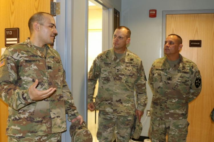 CAMP HUMPHREYS, Republic of Korea – Capt. Joseph Dragonetti, a counselor with the Warrior Behavioral Health Clinic, explains some of the functions of the clinic to Maj. Gen. D. Scott McKean, 2nd Infantry Division/Republic of Korea-U.S. Combined Division commanding general and Command Sgt. Maj. Philip Barretto, 2ID/RUCD senior enlisted advisor, after the official grand opening of the clinic on Camp Humphreys, June 27. (U.S. Army photo by Staff Sgt. Cody Harding, 2ID/RUCD Public Affairs)