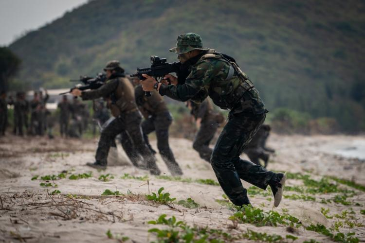 Royal Thai, Republic of Korea and U.S. reconnaissance Marines storm a beach during an amphibious assault exercise as part of exercise Cobra Gold at Hat Yao Beach, Sattahip, Kingdom of Thailand, Feb. 16, 2019. Cobra Gold demonstrates the commitment of the Kingdom of Thailand and the United States to our long-standing alliance, promotes regional partnerships and advances security cooperation in the Indo-Pacific region. (U.S. Marine Corps photo by Staff Sgt. Matthew J. Bragg)