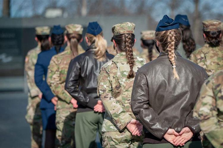 As an outcome of the 101st Air Force uniform board, Air Force women will be able to wear their hair in up to two braids or a single ponytail with bulk not exceeding the width of the head and length not extending below a horizontal line running between the top of each sleeve inseam at the under arm through the shoulder blades. In addition, women's bangs may now touch their eyebrows, but not cover their eyes. These new changes will be effective upon publication of the new standards in Air Force Instruction 36