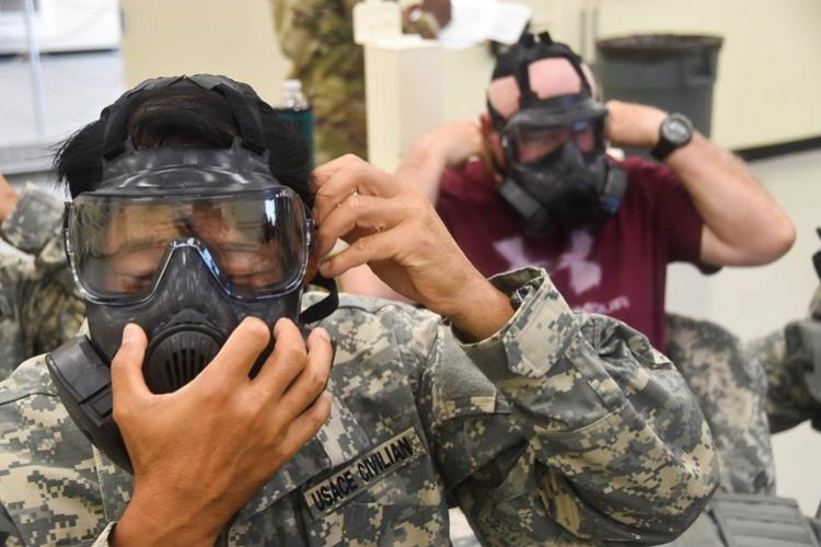 U.S. Army Corps of Engineers, Far East District, Emergency Essential Civilian (EEC) personnel and Mission Essential Civilian (MEC) personnel, practice first-aid techniques during the district's EEC training held at the Vehicle Maintenance Facility, Camp Humphreys, South Korea.