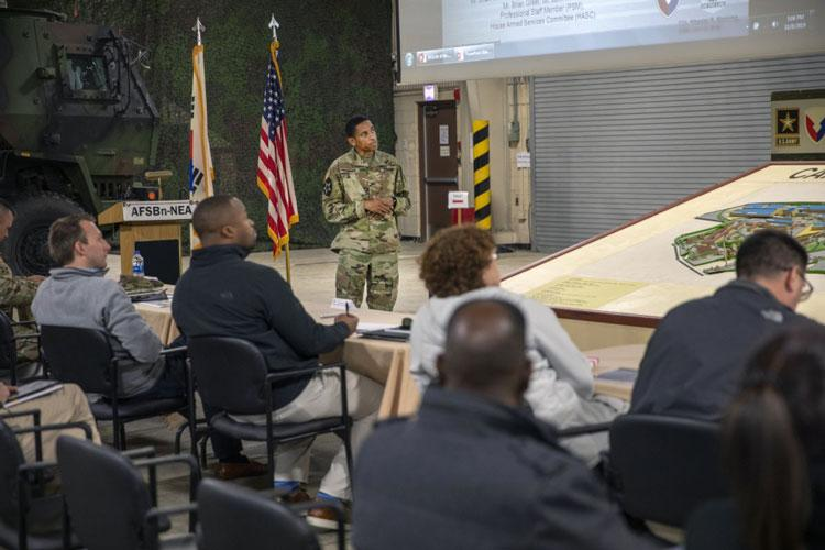 Col. Wheeler Manning, commander, 403rd Army Field Support Brigade, briefs staff members from the House Armed Services Committee Subcommittee on Readiness on brigade operations at Camp Carroll, South Korea, Nov. 8. (Photo by Staff Sgt. Michael Reinsch, 19th ESC Public Affairs)