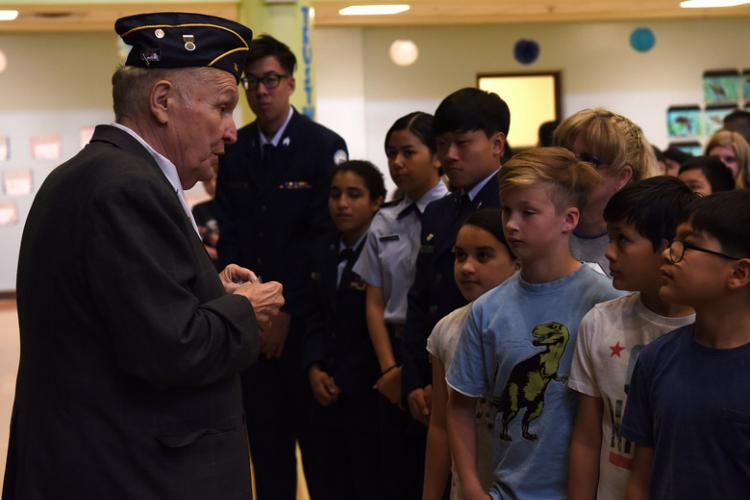 Ret. U.S. Army Sgt. Maj. Chris Vaia, member of American Legion Post 38, talks to Osan Elementary School students about proper U.S. flag etiquette at Osan Air Base, Republic of Korea, May 9, 2019. Vaia talked to third to fifth grade students about the history of the U.S. flag and what the stars, stripes and colors represent. (U.S. Air Force photo by Staff Sgt. Sergio A. Gamboa)