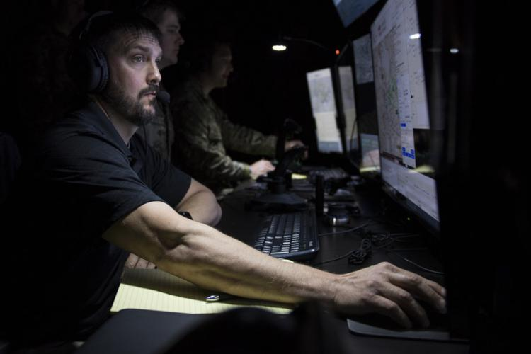 Mike Oser, 607th Air Support Operations Group simulator program manager, operates a joint terminal attack control (JTAC) simulator for Team Osan and U.S. Forces Korea leadership to display features available in their new facility at Osan Air Base, Republic of Korea, May 31, 2019. The new Airman-centric facility will enhance the command and control capabilities of the unit for years to come. (U.S. Air Force photo by Staff Sgt. Ramon A. Adelan)