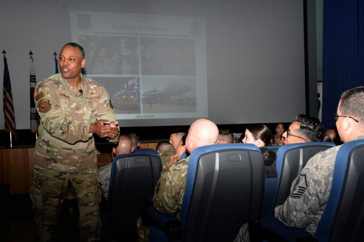 Chief Master Sergeant Anthony Johnson, Pacific Air Forces command chief, speaks to Airmen stationed at Osan Air Base, Republic of Korea, August 2, 2019. Johnson discussed his views on the importance of understanding the culture and climate Airmen live in, as well as remaining resilient in and out of the workplace. (U.S. Air Force photo by Tech. Sgt. Matt Davis)