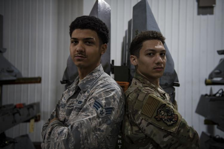 Fraternal twins Jordan and Quinn Harrison, both Senior Airmen from the 51st Munitions Squadron, pose for a photo, Oct. 25, 2019, at Osan Air Base, Republic of Korea. (U.S. Air Force photo by Staff Sgt. Gregory Nash)