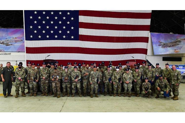 Col. John Gonzales, 51st Fighter Wing commander, far left, and Chief Master Sgt. Justin Apticar, 51st FW command chief, far right, pose for a photo with 51st FW master sergeant selects during a release party ay Osan Air Base, Republic of Korea, May 20, 2021. (U.S. Air Force photo by Senior Airman Noah Sudolcan)