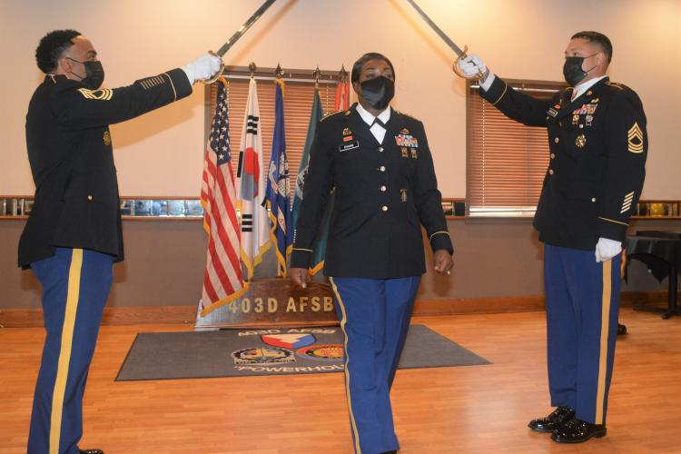 Photo By Galen Putnam   Master Sgt. Gaylynn Evans, brigade victim advocate, 403rd Army Field Support Brigade at her promotion ceremony to master sergeant Oct. 6, 2021.