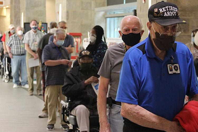 Armed Forces Retirement Home residents line up to receive their COVID-19 vaccine. The Department of Defense recommends that adults ages 75 and older should now receive a COVID-19 vaccine as part of its official Vaccination Program across the United States. The DoD and the Military Health System is encouraging all beneficiaries in that age group to access vaccines through their closest military medical treatment facility. (Photo by Carolyn Haug, Armed Forces Retirement Home.)
