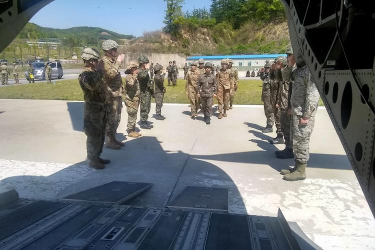 Religious support professionals from the US Army, Air Force and ROK Army conduct a hasty ramp ceremony for notional fallen comrade at the ROK Army Special Warfare Center. ROK Army Chaplain, Maj. Myungshin Kim, proceeds with the honor detail.