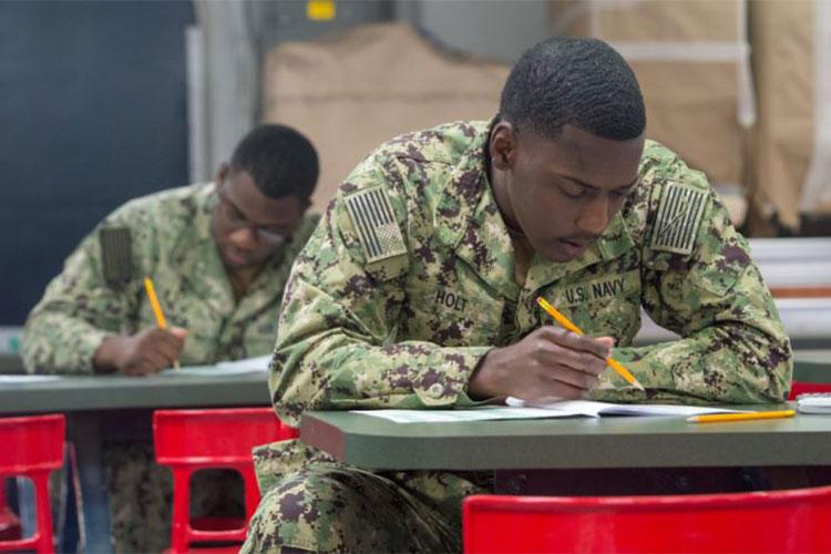 SAN DIEGO (March 21, 2019) Aviation Electronics Technician Tyrese Holt, attached to the amphibious assault ship USS Makin Island (LHD 8), takes the Navywide advancement exam on the ship's mess decks. The exam tests the Sailor's specific rate knowledge level. Makin Island, currently homeported in San Diego, is conducting a depot-level maintenance period. (U.S. Navy photo my Mass Communication Specialist 3rd Class Jeremy Laramore)