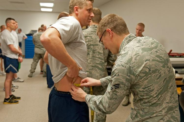 Senior Airman Chris Barrier from the 124th Security Forces Squadron gets his waist measured during his annual fitness assessment in Apr. 2015. The Air Force is considering administering the abdominal circumference test at a separate time from the rest of the physical fitness assessment. CASSIE MORLOCK/U.S. AIR FORCE