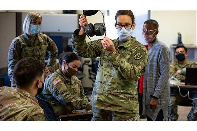 Army Capt. Theresa Galan, chief of the Landstuhl Regional Medical Center Hearing Conservation Clinic, provides training to soldiers on hearing loss prevention and hearing protection fitting in Vicenza, Italy, Jan. 26 (Photo by Army Staff Sgt. Jacob Sawyer).