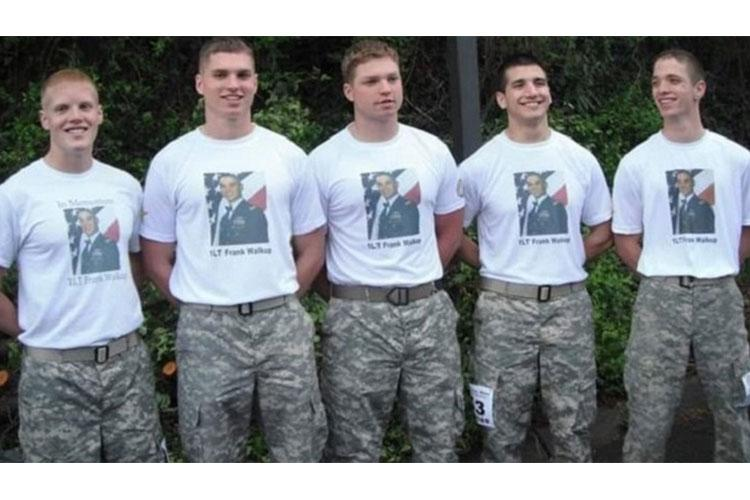 Three of the nine Walkups – Army Capt. Jacob Farmer (family friend), Capt. Benford (Mitch) Walkup, Sgt. Franz Walkup, Carlos Jerez (family friend) and Capt. Kevin Walkup (left to right) wearing matching t-shirts honoring their brother and friend, Army 1st Lt. Frank Walk-up. (Courtesy Photo.)