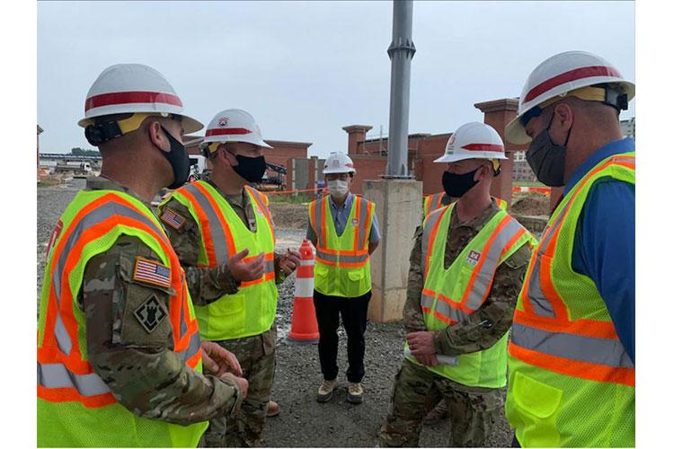 Brig. Gen. Kirk Gibbs, U.S. Army Corps of Engineers Pacific Ocean Division commander (top left), and Command Sgt. Maj. Douglas Galick, POD command sergeant major (top right), visit FED construction site, FH100 Army Family Housing Towers, to view ongoing construction and to speak with the project delivery team at USAG Humphreys, Aug. 25. rmy Family Housing Towers at USAG Humphreys, Aug. 25.