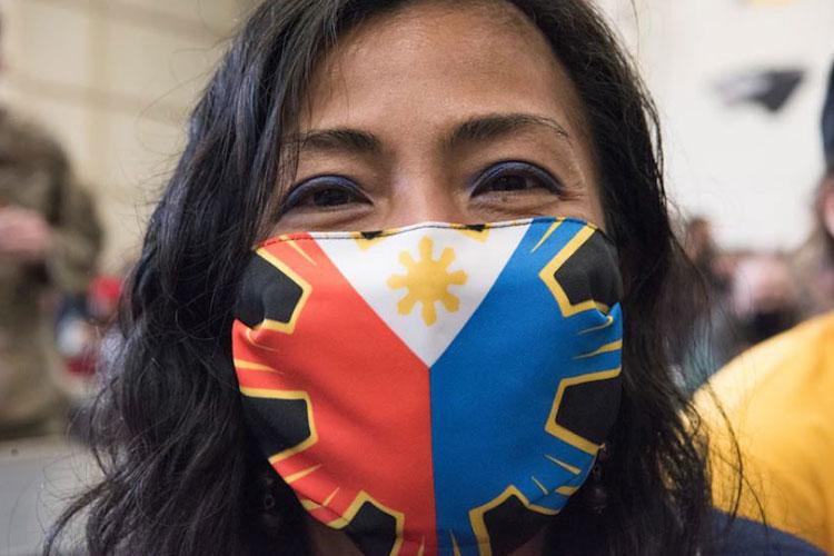 Senior Master Sgt. Mary Anne Chambers, 8th Comptroller Squadron superintendent, shows off her Filipino flag mask during the Diversity and Inclusion Day at Kunsan Air Base, Republic of Korea April 12, 2021. Participants enjoyed cultural performances and food, as well as discussions and activities related to the day's theme, 'Heritage through Diversity.' (U.S. Air Force photo by Tech. Sgt. Will Bracy)